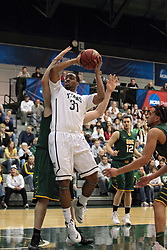 08 March 2014:  Eric Dortch during an NCAA mens division 3 2nd Round Playoff basketball game between the St Norbert Green Knights and the Illinois Wesleyan Titans in Shirk Center, Bloomington IL