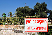 Israel, Haifa Bay Area, Sewerage treatment facility The gardens are irrigated with treated waste water. A warning sign reading: Irrigated with treated waste water drinking prohibited