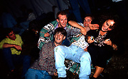 Group of friends sitting on grass at the first outdoor rave up North, The Gio Goi Joy Rave run by Anthony and Chris Donnelly, Ashworth Valley, Rochdale, 5th August 1989.