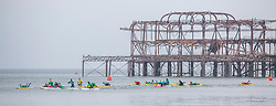 © Licensed to London News Pictures. 17/03/2019. Brighton, UK. Members of the Brighton Surf Life Saving Club take to the sea in Brighton and Hove as milder weather hits Brighton and the South Coast. Photo credit: Hugo Michiels/LNP