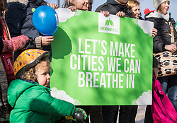 © Licensed to London News Pictures. 24/02/2018. London, UK. 3-year-old Raoul Mullen (L) joins Green Party activists on Brixton Road, London's most polluted street, as part of their 'Breathing Cities' campaign to reverse air pollution in Britain's cities. Photo credit: Rob Pinney/LNP