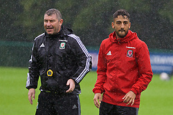 CARDIFF, WALES - Saturday, September 3, 2016: Wales' Neil Taylor and assistant manager Osian Roberts during a training session at the Vale Resort ahead of the 2018 FIFA World Cup Qualifying Group D match against Moldova. (Pic by David Rawcliffe/Propaganda)