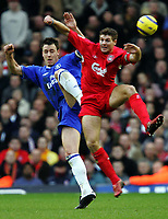 Photo:Ryan Browne/Back Page Images.<br />Liverpool v Chelsea, FA Barclays Premiership, Anfield, 01/01/05<br />Chelsea's John Terry left is outjumped byLiverpool's Steven Gerrard