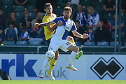 Matt Taylor and Jake Wright battle for the ball during the Sky Bet League 2 match between Bristol Rovers and Oxford United at the Memorial Stadium, Bristol, England on 6 September 2015. Photo by Alan Franklin.