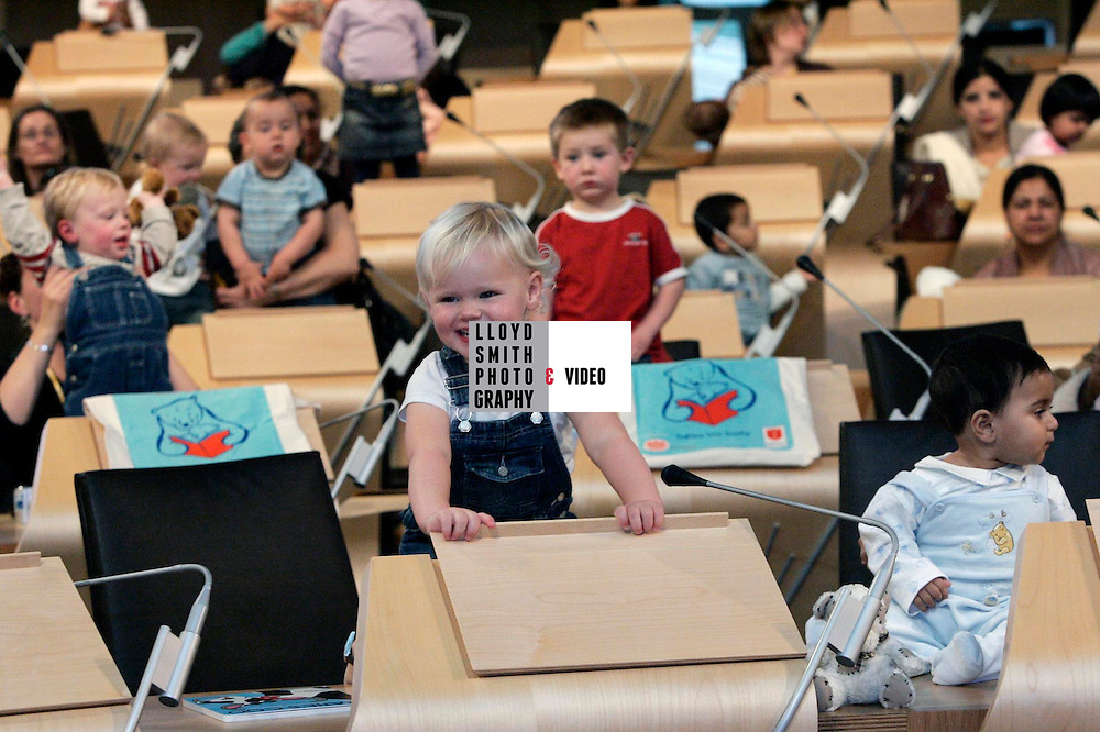 07/10/05 /1 <br /> <br /> The launch of National  Bookstart day at the Scottish Parliament. Babies with there mothers pictured here in the debating chamber at the Scottish Parliament. Baby in the centre of the picture is Melissa Heron