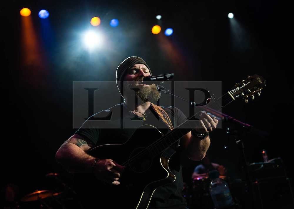 "© Licensed to London News Pictures. 01/07/2013. London, UK.   Zac Brown of Zac Brown Band performing live at Shepherds Bush Empire. Zac Brown Band is Grammy award winning American country/folk band based in Atlanta, Georgia. The lineup consists of Zac Brown (lead vocals, guitar), Jimmy De Martini (fiddle, vocals), John Driskell Hopkins (bass guitar, vocals), Coy Bowles (guitar, keyboards), Chris Fryar (drums), Clay Cook (guitar, keyboards, mandolin, steel guitar, vocals), and Daniel de los Reyes (percussion).  in 2013 the band won a Grammy for Best Country Album with ""Uncaged"", and since forming they have earned a total of 55 award nominations & won 7 from the Grammys, Academy of Country Music, American Music Awards, Country Music Association and Country Music Television. Photo credit : Richard Isaac/LNP"