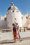Indigenous pilgrims walk past the Sanctuary of Atotonilco an important Catholic shrine in Atotonilco, Mexico.