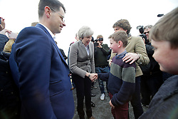 © Licensed to London News Pictures. 13/05/2017. Lisburn, UK. British prime minister THERESA MAY  shakes hands with Ben Foster, DUP leader Arlene Foster's son, during a visit to Balmoral Show at Balmoral Park in Lisburn, Northern Ireland,  while campaigning ahead of a general election which takes place on June 8, 2017.  Photo credit: Kalista McErlane/LNP