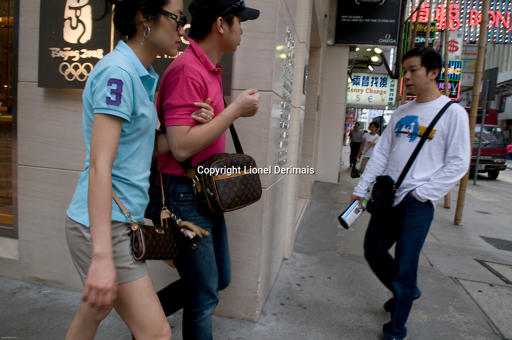 Couple carrying Louis Vuitton bags, Causeway Bay area, Hong Kong
