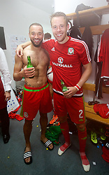 ZENICA, BOSNIA & HERZEGOVINA - Saturday, October 10, 2015: Wales Ashley 'Jazz' Richards and Chris Gunter celebrate in the dressing room after qualifying for the finals despite a 2-0 defeat to Bosnia and Herzegovina during the UEFA Euro 2016 qualifying match at Stadion Bilino Polje. (Pic by David Rawcliffe/Propaganda)