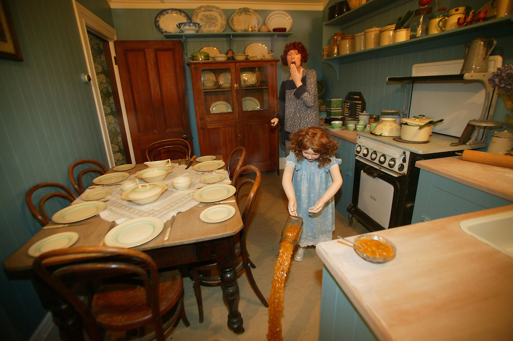 A lifelike child model spills the contents of a jar as her horrified 'mother' looks on in a 50s kitchen setting at Tawhiti Museum, Hawera, New Zealand, June 21, 2004.  The models are handmade by the museum's curator and owner, Nigel Ogle. Credit:SNPA / Rob Tucker