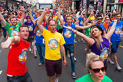Brighton, August 2nd 2014. Dance with Ziggy revellers take part in the Brighton Pride procession