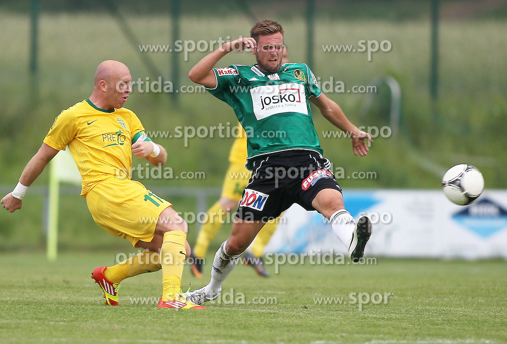 22.06.2012, Sportplatz SK Kammer, Kammer, AUT, 1. FBL, Testspiel, SV Josko Ried vs MSK Zilina, im Bild Miroslav Barcik, (MSK Zilina, #11) und Emanuel Schreiner, (SV Josko Ried, #19)// during Preparation Game for the 1. FBL between SV Josko Ried and MSK Zilina at the Sportplatz SK Kammer, Kammer, Austria on 2012/06/22 . EXPA Pictures © 2012, PhotoCredit: EXPA/ R. Hackl