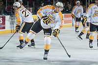 KELOWNA, CANADA - OCTOBER 25:  Duncan Campbell #25 of Brandon Wheat Kings takes a shot during warm up against the Kelowna Rockets on October 25, 2014 at Prospera Place in Kelowna, British Columbia, Canada.  (Photo by Marissa Baecker/Shoot the Breeze)  *** Local Caption *** Duncan Campbell;