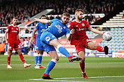 Peterborough United defender Jason Naismith (2) with this effort at the back post during the EFL Sky Bet League 1 match between Peterborough United and Accrington Stanley at London Road, Peterborough, England on 20 October 2018.