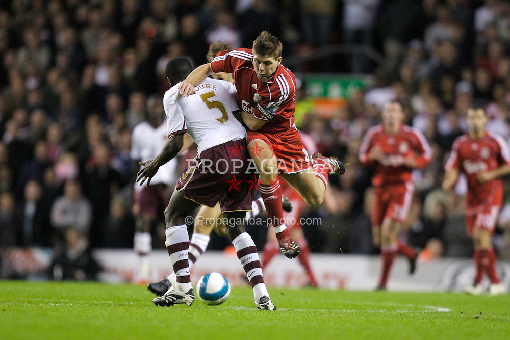 LIVERPOOL, ENGLAND - Sunday, October 28, 2007: Liverpool's captain Steven Gerrard MBE and Arsenal's Kolo Toure during the Premiership match at Anfield. (Photo by David Rawcliffe/Propaganda)