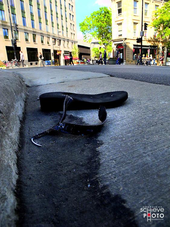 Flip flop in the gutter.