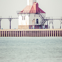 St. Joseph Michigan Lighthouse vertical panorama photo. Photo has retro vintage tone. The St. Joseph Michigan Lighhouse is a popular local attraction along Lake Michigan in Southwest Michigan. Panoramic photo ratio is 1:3. Image Copyright © Paul Velgos All Rights Reserved.