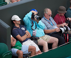 LONDON, ENGLAND - Tuesday, June 29, 2010: Photographers taking a rest as they wait for a match on day eight of the Wimbledon Lawn Tennis Championships at the All England Lawn Tennis and Croquet Club. (Pic by David Rawcliffe/Propaganda)