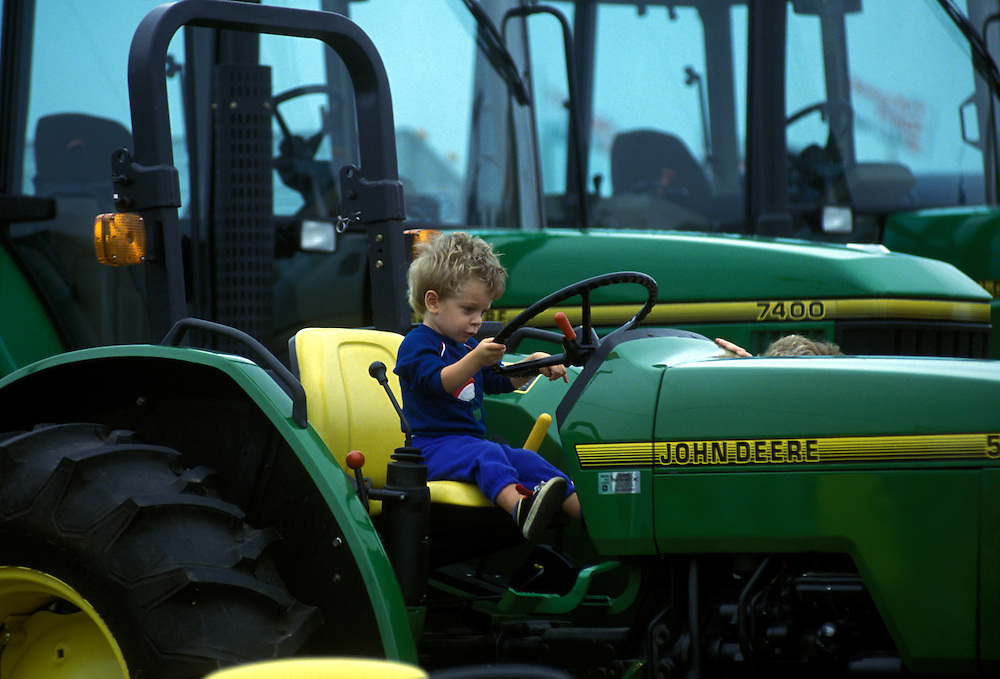 Child in the driver's seat of a tractor