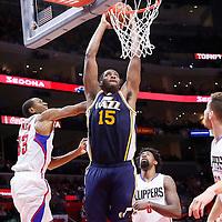 25 November 2015: Utah Jazz forward Derrick Favors (15) goes for the dunk past Los Angeles Clippers guard Wesley Johnson (33) and Los Angeles Clippers center DeAndre Jordan (6) during the Utah Jazz 102-91 victory over the Los Angeles Clippers, at the Staples Center, Los Angeles, California, USA.