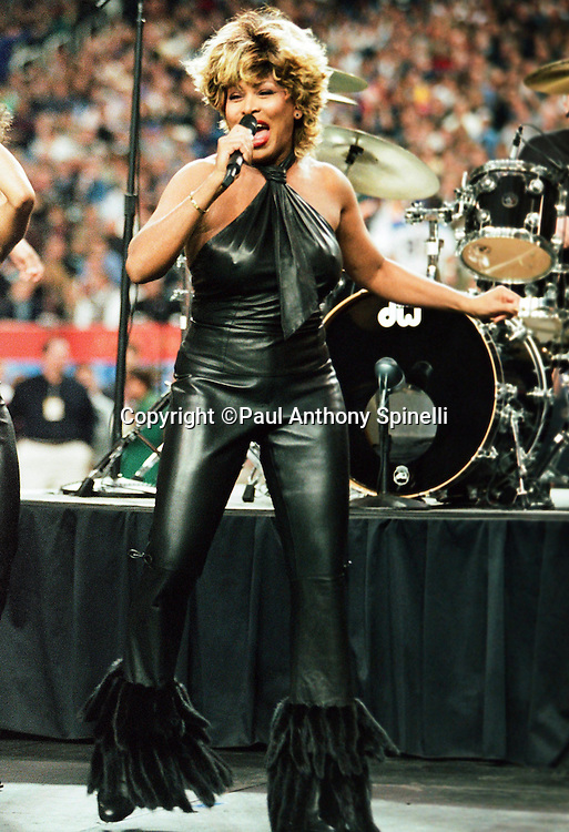 Singer performer Tina Turner sings as part of the halftime show at Super Bowl XXXVI during the St. Louis Rams NFL football game against the Tennessee Titans on Jan. 30, 2000 in Atlanta. The Rams won the game 23-16. (©Paul Anthony Spinelli)