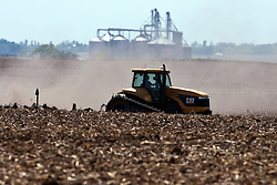 12 May 2009: A farmer leaves a cloud of dust behind his tractor while pulling an implement.