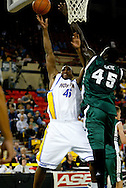 11/23/2006 - Anchorage, Alaska: Hofstras Sophomore forward Mike Davis-Sabb (45)attempts a shot over Senior forward Ahmet Gueye (45) of the Hawaii Warriors as Hawaii defeats Hofstra 80-79 at the 2006 Great Alaska Shootout on Thanksgiving night<br />