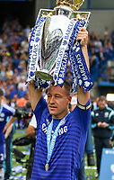 Football - 2014 / 2015 Premier League - Chelsea vs. Sunderland.   <br /> <br /> Chelsea's John Terry  with the Premier League Trophy at Stamford Bridge. <br /> <br /> COLORSPORT/DANIEL BEARHAM