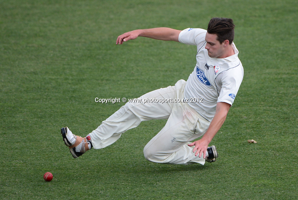 Mitchell McClenaghan fielding for Auckland. Plunket Shield Cricket, Auckland Aces v Northern Knights at Eden Park Outer Oval. Monday 12 November 2012. Photo: Andrew Cornaga/Photosport.co.nz