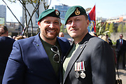 Royal Marines catch up before the demonstration in support of Soldier F by former service personnel in Central Manchester on 19 April 2019.