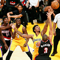 11 October 2016: Los Angeles Lakers forward Nick Young (0) vies for the rebound with Portland Trail Blazers guard C.J. McCollum (3) next to Los Angeles Lakers forward Luol Deng (9), Portland Trail Blazers forward Noah Vonleh (21) and Los Angeles Lakers forward Julius Randle (30) during the Portland Trail Blazers 109-106 OT victory over the Los Angeles Lakers, at the Staples Center, Los Angeles, California, USA.