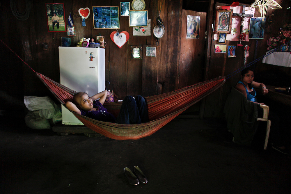 In this photo taken on Sunday, Sept. 11, 2011. A leukemia patient Maria Jose Martinez, fifteen  years old, rest on the hammock at her living room in her house, at 'Las Cuchillas' in the rural area of Matagalpa city, this was the exact day of her 15th birthday, she is waiting to celebrate with her twin sister the mass with friends and neighbors.