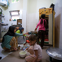 Aicha's family, mother, older sister, younger sister and niece, in the kitchen for the preparation of the lunch.