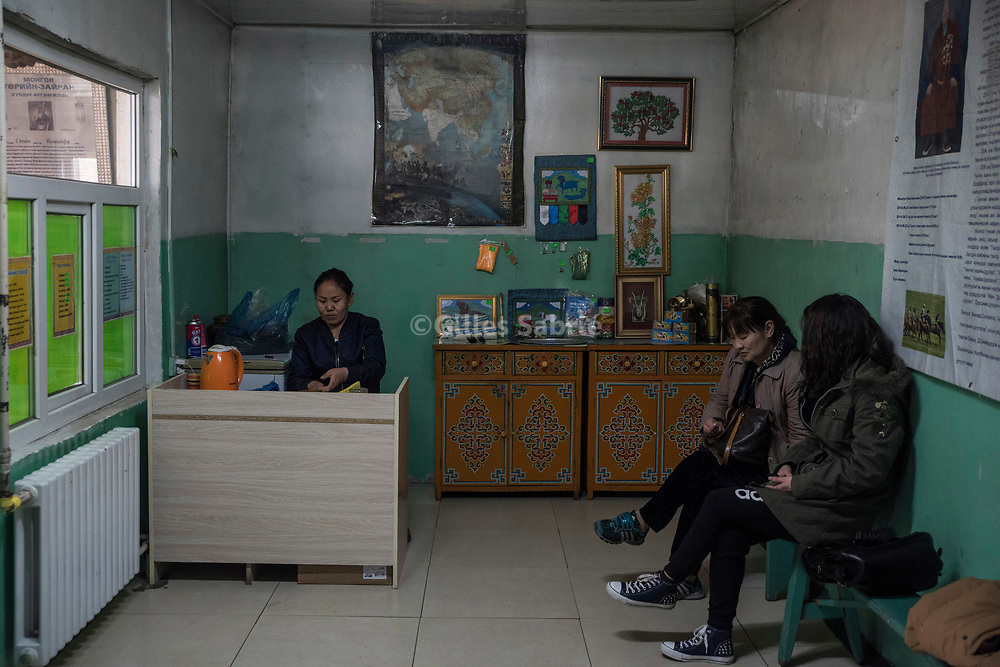 Ulaanbaatar, MONGOLIA, April 5th 2017<br /> Two women in the waiting room of Byambadorj's home waiting for an audience with the master shaman.  When connected with their spirit shamans are believed to possess a wide-ranging array of powers, from curing health problems, to removing or casting curses, including fortune telling. <br /> Gilles Sabri&eacute; for 1843