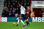 Joe Gomez (12) of Liverpool holds off \Ryan Fraser (24) of AFC Bournemouth during the Premier League match between Bournemouth and Liverpool at the Vitality Stadium, Bournemouth, England on 7 December 2019.