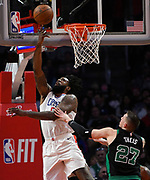 LA Clippers center DeAndre Jordan #6 goes for a layup against Boston Celtics forward Daniel Theis #27 in the 4th quarter. The Los Angeles Clippers were defeated by the Boston Celtics 113-102 in a regular season NBA matchup in Los Angeles, CA 1/025/2018 (Photo by John McCoy, Los Angeles Daily News/SCNG)