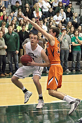 01 March 2014:  Brady Zimmer works against Peter Smith to get off a shot from the paint during an NCAA mens division 3 CCIW  Championship basketball game between the Wheaton Thunder and the Illinois Wesleyan Titans in Shirk Center, Bloomington IL