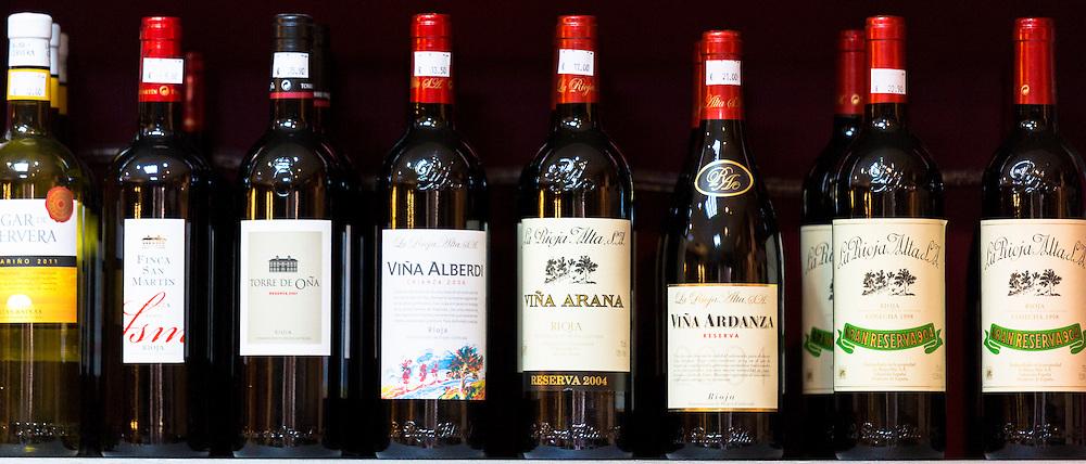 Rioja red wines Vina Ardanza, Vina Arana and La Rioja Alta on display in Pepita Uva shop in Laguardia, Rioja-Alavesa, Spain