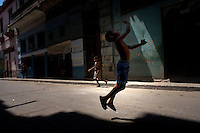 cuban boys playing in street