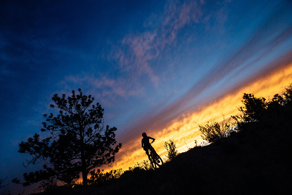 Heather Goodrich silhouetted along the Canyons Trail after sunset in Curt Gowdy State Park in Eastern Wyoming.
