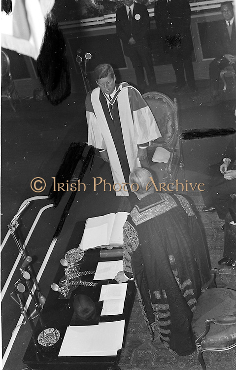President John F. Kennedy receives an honorary degree from the National University of Ireland during a ceremony at St Patrick's Hall, Dublin Castle.