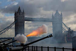 © Licensed to London News Pictures. 14/11/2013. London, UK. A gun fires in front of Tower Bridge as members of the Honourable Artillery Company (HAC) fire a 62 gun salute at Tower Wharf outside the Tower of London to mark Prince Charles birthday today. Photo credit : Vickie Flores/LNP