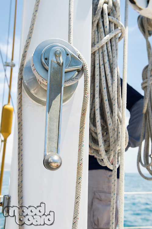 Winch handle and rope on yacht