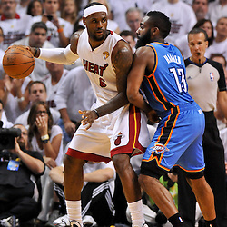 Jun 17, 2012; Miam, FL, USA; Miami Heat small forward LeBron James (6) is guarded by Oklahoma City Thunder guard James Harden (13) during the first quarter in game three in the 2012 NBA Finals at the American Airlines Arena. Mandatory Credit: Derick E. Hingle-US PRESSWIRE
