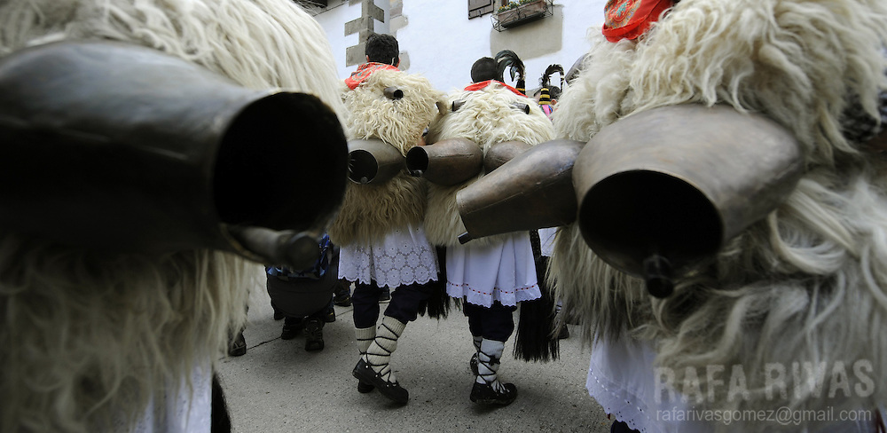 """A group of """"Joaldunak"""" (""""those who play the bell"""") march carrying big cowbells tied to their backs as they take part in the ancient carnival of Ituren, in the northern Spanish province of Navarra province, on January 30, 2012."""