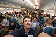 Airbus A380 first commercial flight - Singapore Airlines SQ 380 Singapore-Sydney on October 25, 2007. Economy Class celebrating take-off.