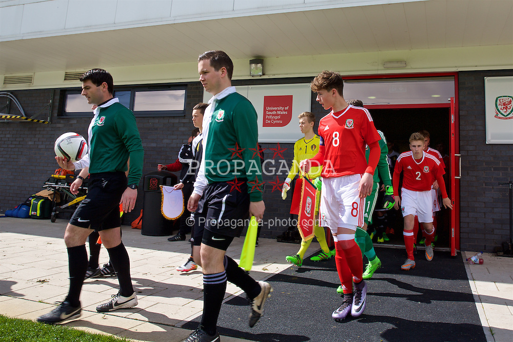 NEWPORT, WALES - Tuesday, April 26, 2016: Wales' captain Terry Taylor leads his side out to face Belgium before the Boys U15's Tri-Nations Tournament at Dragon Park. (Pic by Mark Hawkins/Propaganda)