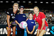 ANZ Future Captains Heather Kibby aged 13 (L) and Natalie Barclay aged 8 (R) with Leana de Bruin of the Magic and Anna Thompson of the Tactix. 2015 ANZ Championship, Waikato Bay of Plenty Magic v Canterbury Tactix, Claudelands Arena, Hamilton, New Zealand. Photo: Anthony Au-Yeung / www.photosport.co.nz