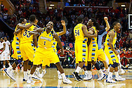 Mar 20, 2011; Cleveland, OH, USA; Marquette players celebrate their win over Syracuse during the third round of the 2011 NCAA men's basketball tournament at Quicken Loans Arena.
